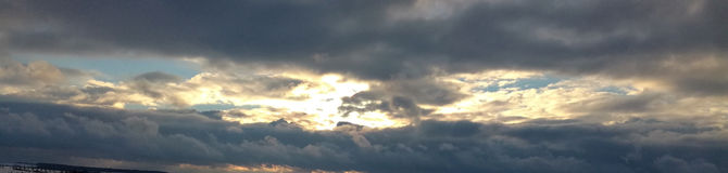 Winter sky. Sun lights shining through the clouds Royalty Free Stock Photo
