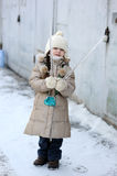 Winter small girl with long hair holds big icicle Stock Images