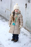 Winter small girl with long hair holds big icicle Royalty Free Stock Images