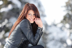 Winter Smile. Young woman smiling into the camera with finger in her mouth Royalty Free Stock Photos