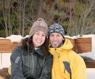 Winter Smiles. A couple smile while posing for a winter portrait Royalty Free Stock Photography