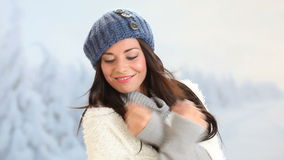 Winter smiling young woman stock footage