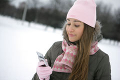 Winter sms. Girl in the park in winter. Hand. Sign ok Stock Images