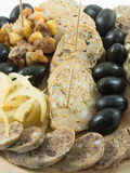 Winter snack. Traditional winter meal (olives, pork, scraps Stock Photo