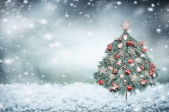 Winter snow background with decorated Christmas tree. Front view royalty free stock image