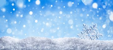 Free Winter Snow Background With Decorative Snowflake Against Blue Sky. Banner Format. Beautiful Wintertime Holiday Scene Royalty Free Stock Photo - 162735915