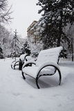 Winter, snow on the bench building Stock Images