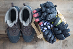 Winter snow boots with gloves and mittens Stock Images