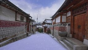 Time lapse.of Bukchon Hanok Village. frozen under snow on a stormy snowy day during winter in Seoul, Korea.