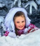 Winter with snow for child girl in clothes near tree in park. Royalty Free Stock Image