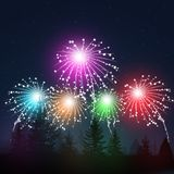 Fireworks in Snow Forest. Winter snow christmas background with fireworks in forest Stock Photo