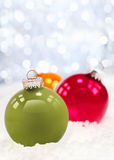 Winter snow and Christmas bauble Stock Photos