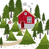 Winter snow covered forest and rural house with a chimney. Stock Photo