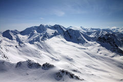 Winter snow covered mountain peaks in Austrian alps Royalty Free Stock Images