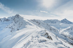 Winter snow covered mountain peaks in Europe. Great place for winter sports. Royalty Free Stock Photos