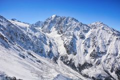 Winter snow covered mountain peaks. Tourists Ala-Archa National Park in Kyrgyzstan royalty free stock photo