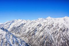 Winter snow covered mountain peaks. Tourists Ala-Archa National Park in Kyrgyzstan royalty free stock image