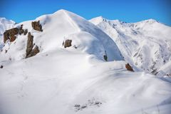Winter snow covered mountain peaks. Tourists Ala-Archa National Park in Kyrgyzstan stock photo