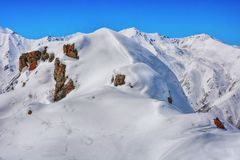 Winter snow covered mountain peaks. Tourists Ala-Archa National Park in Kyrgyzstan stock photos