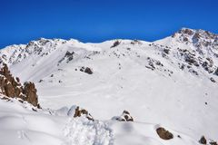 Winter snow covered mountain peaks. Tourists Ala-Archa National Park in Kyrgyzstan stock image