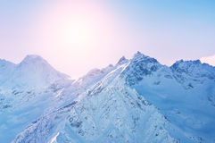 Winter snow covered mountains at sunset Stock Images