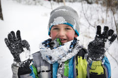 In winter, snow-covered pine forest a boy standing in the snow. Stock Photo