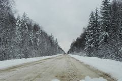 Winter snow-covered road. Beautiful forest, nature and road covered with snow. Details and close-up. royalty free stock photo