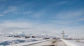 Winter  snow-covered road in the Georgian mountains Royalty Free Stock Images