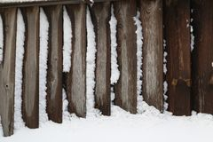 Wooden Fence. Snow-covered wooden fence in winter. Winter. Snow-covered wooden fence in winter royalty free stock photo