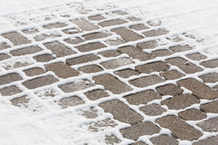 Winter: Snow Covering a Brick Sidelwalk Royalty Free Stock Image