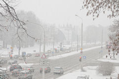 Winter snow disaster in a city. snowstorm on a road, cars in snow. Snowstorm on a road. Winter snow disaster in a city, cars in snow Royalty Free Stock Images