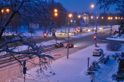Winter snow disaster in a city. snowstorm on a road, cars in snow. Top view to avenue covered with snow in early morning or evenin. Top view to avenue covered Stock Photography