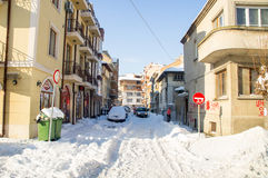 Winter snow drifts on the streets of the old Pomorie in Bulgaria Stock Photos