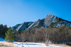 Winter Flatirons with a blue sky royalty free stock image