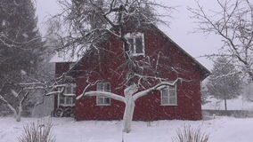 Winter  snow falling and  farm house stock video