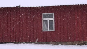 Winter  snow falling and  house wall with window stock video footage