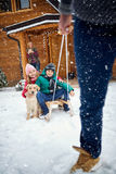 Winter, snow, family sledding at winter time Royalty Free Stock Photography