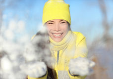 Winter snow fight girl playing throwing snowball Stock Photography