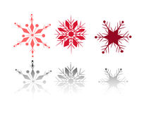 Winter snow flakes. 3 snow flakes with shiny reflections stock illustration