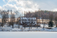 Winter snow frozen lake house cottage forest hill Stock Photos