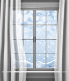 Winter snow gently falling outside the paned window of a house Stock Images