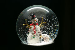 Winter Snow Globe With Snowman on Black Royalty Free Stock Photos