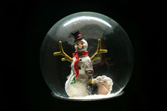 Winter Snow Globe With Snowman on Black Stock Photo