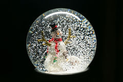 Winter Snow Globe With Snowman on Black Stock Images