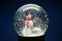 Winter Snow Globe With Snowman on Blue Stock Photos