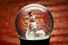 Winter Snow Globe With Snowman on Red Royalty Free Stock Images