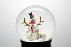 Winter Snow Globe With Snowman on White Stock Images
