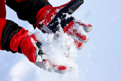 Winter Snow Gloves. Winter red Snow Gloves and snow royalty free stock image