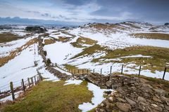 Winter Snow on Hadrian`s Wall above Cawfield Crags Stock Photography