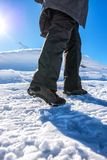 Winter snow hiking, woman walking on snowy path. Low angle view Stock Photos